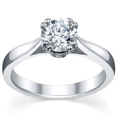 Round diamond solitaire engagement ring from DeBebians.