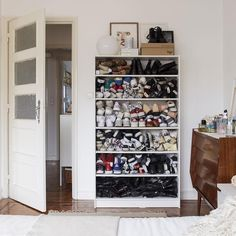 Get creative with your bedroom storage. Fashion blogger Carolina keeps her shoe collection in an old bookcas