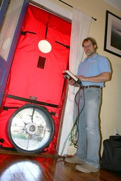Mark Bashista, with Home Performance NC, performs an energy audit.