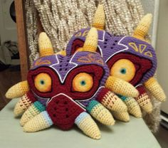 Majora's Mask pillow the evil mask rendered as a by SunnyDeo https://www.etsy.com/listing/222246157/majoras-mask-pillow-the-evil-mask?ref=sr_gallery_16&ga_search_query=zelda+plush&ga_page=4&ga_search_type=all&ga_view_type=gallery