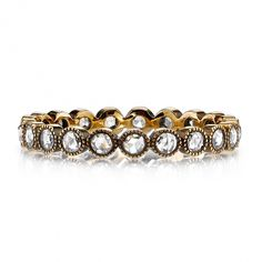 0.55ctw Rose cut diamonds set in a handcrafted 18K oxidized yellow gold eternity band.