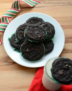 Santa will be sure to love these! Amazing Mint Dipped Double Chocolate Cookies from www.blessthismessplease.com