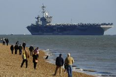 Thousands of spectators lined the banks of the River Solent in Hampshire today to welcome the 1,092ft-long USS Theodore Roosevelt as it arrived for a five-day visit to the UK. The U.S. aircraft carrier, which measures 1,092ft in length, docked off Stokes Bay in Gosport, Hampshire