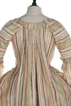 Detail rear view, robe à la francaise, 1770s. Chine silk taffeta woven in shades of green pink an divory stripes, fabric trim, linen linings.