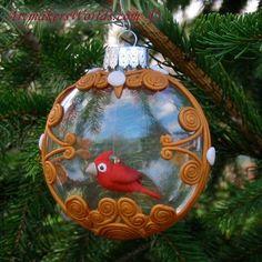 Cardinal inside a glass filigree ornament | ArtmakersWorlds -
