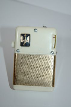 Vintage item from the 1950s: bakelite, metal, transistor radio