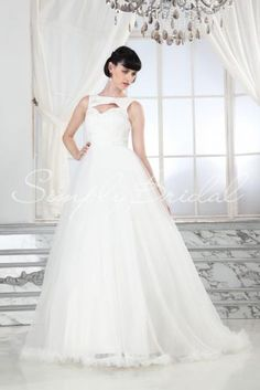 Wedding Dress by SimplyBridal. The Pandora gown. The lace bodice on this dramatically girly ball gown is sure to keep all eyes on the bride. The pleated tulle skirt is exquisitely adorned with feather like tulle along the hem. This is the perfect princess dress and would flatter any ty. USD $779.99