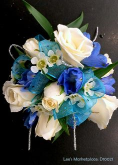 One of the beautiful custom dance or wedding corsages designed by Lee's Corner Floral. Learn more or order yours today at leesmarketplaceflorallogan.com