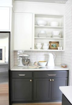 two toned kitchen cabinet trend is hot right now. #Kitchen #Cabinets Diy kitchen remodel, Oak kitchen remodel and Painted kitchen cabinets.