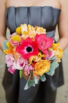 neutral bridesmaids dresses + colorful flowers