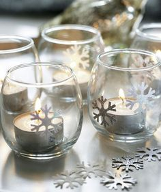 9 Homemade Holiday and Christmas Decorations Frosty Lights - Want to create a tabletop winter wonderland? Add snowflake stickers to clear glass votives and sprinkle them along your tablescape. Winter Wonderland Decorations, Winter Wonderland Theme, Winter Wonderland Christmas, Winter Christmas, Winter Decorations, Baby Shower Winter Wonderland, Diy Snowflake Decorations, Snowflake Party, Wonderland Party