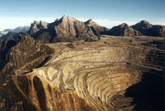 Grasberg is no longer a hill, rather it's now one of the largest open pit mines in the world.  The engineering involved with digging such a hole, separating the valuable minerals from the rock, & then transporting the valuable stuff down to civilization is truly awesome. grasberg_mine_08.jpg 640×432 pixels