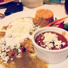 De Pollo Enchiladas: two hand rolled enchiladas filled with chicken. Served with rice, frijoles bayos and covered in salsa verde
