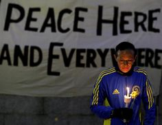 a candle and a flower at Boston Common during a vigil for the victims of the Boston Marathon explosions, April 16, 2013. (Julio Cortez/AP Photo)