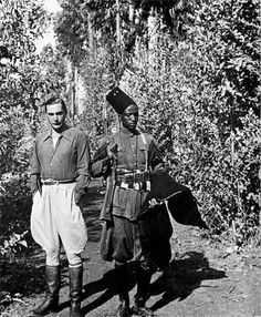 Curzio Malaparte with an Ethiopian soldier, Ethiopia, 1939 Fascist Architecture, Black And White Man, Black History, Hipster, Glamour, Guys, Portrait, Celebrities, Writers