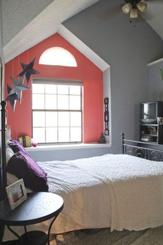 Gray and coral bedroom.. Like the window seat/cutout too