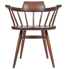 George Nakashima Studio Captains Chair | From a unique collection of antique and modern chairs at https://www.1stdibs.com/furniture/seating/chairs/