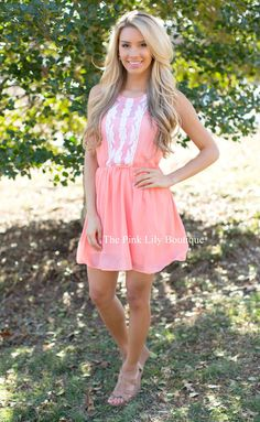 This new I'll Be Waiting dress features the sweetest white detail and is the perfect spring color!
