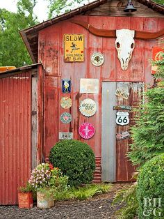 Express your personality by outfitting an outbuilding or porch wall with meaningful signage. On this structure, vintage advertising signs, outdated license plates, and road signs combine to fashion a fetching exhibit that reflects the homeowners' travels and interests.