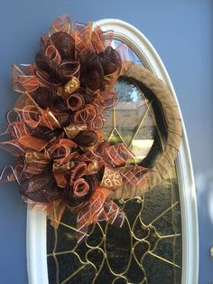 A personal favorite from my Etsy shop https://www.etsy.com/listing/248916497/fall-wreath-deco-mesh