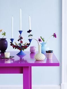 A fuchsia table decorated with pretty purple & blue hues - feminine and fun.