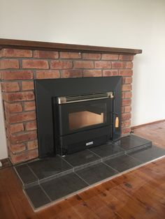 Builg in wood fire that I supply and fit. A new customised slate coloured tiled hearth I also built.