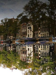Buildings reflected in the Singel canal, Amsterdam, Holanda. Amsterdam Canals, Amsterdam City, Amsterdam Travel, Amsterdam Sights, Places Around The World, Around The Worlds, Beautiful World, Beautiful Places, Places To Travel