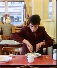 Phil Daniels tucking into a traditional London favourite - pie & mash (usually with liquor and a glass of sasperilla).