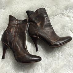 Gianni Bini brown leather boots size 7 1/2 These boots are in great condition! They are gorgeous soft leather. Wood heel. Rubber soles. Genuine leather. Natural weathered look. Zip up on inside of boot. 3 3/4 inch heel. Smoke free pet free home. There is some wear on the leather on the inside of the boots in a couple places along the seams. Gianni Bini Shoes Ankle Boots & Booties