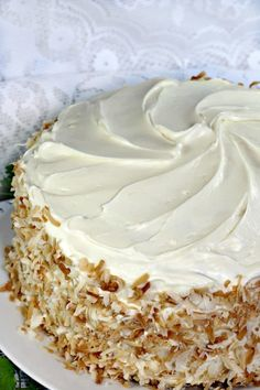 Loaded with carrots, pineapple,coconut,raisins and walnuts this ultimate Classic Carrot Cake Recipe is truly decadent. Finished with a thick layer of cream cheese frosting and toasted coconut makes this cake worthy of any special occasion. Carrot Cake Recipe With Raisins, Classic Carrot Cake Recipe, Best Carrot Cake, Carrot Cakes, Classic Recipe, Carrot Cake With Pineapple, Pineapple Coconut, Cupcakes, Cupcake Cakes