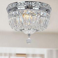 Illuminate your home with this attractive chandelier. This pendant fixture features a chrome finish and crystal glass.