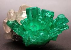 Emerald- (Beyrl)- composed of beryllium aluminium cyclosilicate. Colored green by trace amounts of chromium and sometimes vanadium, hardness of Crystal system Hexagonal Minerals And Gemstones, Rocks And Minerals, Expo Paris, Crystal System, Emerald Gemstone, Raw Emerald, Emerald Green, Green Gem, Emerald City