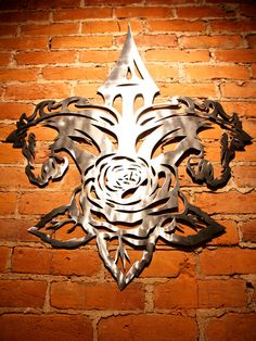 This metalwork piece illustrates the iconic symbols of our city in one motion. The classic Louisville Fleur De Lis, with the Twin Spire and two horses at the top, and a beautiful and intricate rose at the bottom. This piece would be an excellent addition to any room in your house.