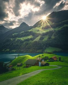 Lungern: A tiny village in Switzerland where 200 people live here. Green plain all around with a tiny lake. Amazing during sunset.