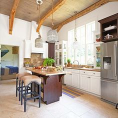 Pretty idea for ceilings and light fixtures in a very large open kitchen.