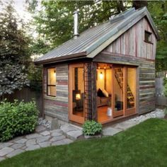 Small Wooden Backyard Shed With Glass Design