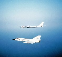 An Convair aircraft belonging to the Fighter Interceptor Wing of the Massachusetts Air National Guard, intercepting a Soviet Bear bomber aircraft off the coast of Yarmouth, Nova Scotia in Military Jets, Military Aircraft, Russian Bombers, National Guard, Cold War, Nova Scotia, Airplanes, Air Force, Weapons