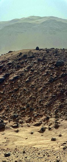 "Panorama of Curiosity images showing the the tallest part of ""Mount"" Remarkable in the foreground with the considerably taller mountains of Gale Crater's rim in the background. Color variant."