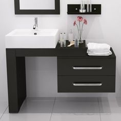 small but beautiful white bathroom with black modern vanity, flowers. Tiny Bathroom, Big Ideas: 5 Space Saving Ideas for Small Bathrooms by Tradewinds I. Bathroom Furniture, Trendy Bathroom, Bathroom Trends, Modern Bathroom, Bathroom Sink Cabinets, Tiny Bathroom, Bathroom Design Small, Bathroom Design, Washbasin Design
