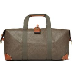 Mulberry. Medium Clipper Holdall Bag. Spacious yet sleek, this Mulberry holdall bag is a classic piece of luggage. Contrasting brown leather trims add a considered edge, while the detachable and adjustable shoulder strap makes this piece a versatile investment. Accessorise it with your passport and a plane ticket.