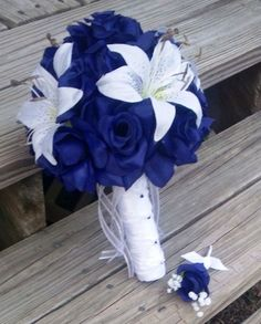 Cute! But cream instead of white and with real flowers.  Silk Bridal Bouquet Blue Roses & White Tiger Lily, Blue Rose Bouquet, Tiger Lily Bouquet, Royal Blue Bouquet, Blue Bouquet via Etsy