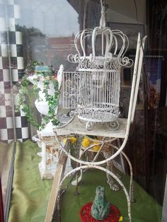 This chair is wonderful with a metal mesh seat and back on a wide iron framework.  The birdcage light fixture is part of a matched   set.  It's all for sale at Picker's Playground!  110 East Union Street, Waupaca, WI  54981
