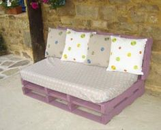 Day bed / patio couch created from recycled / reclaimed industrial pallets painted purple...