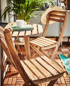 A small table and two foldable chairs create an intimate seating area.