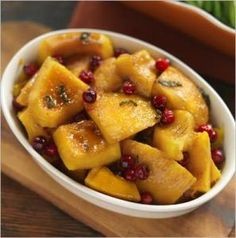 Roasted Pumpkin With Cranberries and Sage Brown-Sugar Butter.