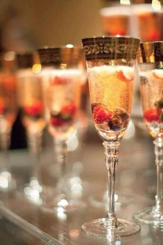 Champagne cocktails with cranberries for decoration. #holidayparty #holidaycocktails #champagne