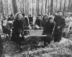 German civilians are forced to carry the exhumed bodies of prisoners of the Neunburg concentration camp to decent burial. Notice the facial expressions.