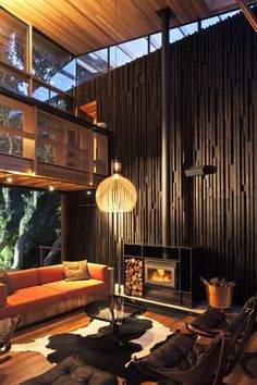 the interior design colors are way too dark for my liking.but I am completely intrigued by the architecture of this room! Under Pohutukawa House by Herbst Architects Architecture Durable, Sustainable Architecture, Interior Architecture, Interior And Exterior, Room Interior, Exterior Design, Building Architecture, Futuristic Architecture, Interior Doors