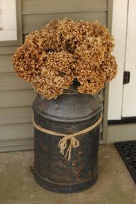 Front Porch fall dec I love this idea with the old milk can but I'm afraid I'll come home and it'll be gone.
