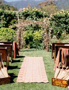 Add a dash of boho with a rug turned aisle runner.  #aisle-decor  Photography: Jose Villa - josevillablog.com  Read More: http://www.stylemepretty.com/2009/05/18/real-wedding-alissa-and-ryan-v/